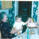 My grandmother holding me on her lap for my first birthday.