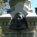 Klácel bust on his grave in Iowa.